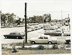 Parking at Nathan Shopping Plaza, view from Patrick Street looking along Nathan Street to Ross River Road, Townsville, 16th January 1971